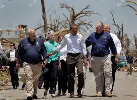Barack Obama President Barack Obama, center right, seen with officials, views damage from the tornado that devastated Joplin, Mo., . Obama is joined by Missouri Gov. Jay Nixon, second from right, and FEMA Director William Fugate, left