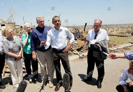 Barack Obama, Jay Nixon, Georganne Wheeler Nixon, Mike Woolston, Claire McCaskill President Barack Obama speaks with reporters after visiting tornado victims in Joplin, Mo., . From left are, Sen. Claire McCaskill, D-Mo., Missouri Gov. Jay Nixon and his wife Georganne, Obama, and Joplin Mayor Mike Woolston