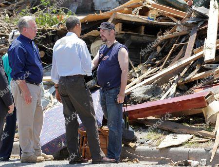 Barack Obama, Jay Nixon President Barack Obama talks with residents as he views damage from the tornado that devastated Joplin, Mo., with Missouri Gov. Jay Nixon, left
