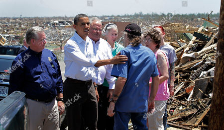Barack Obama President Barack Obama, second from left, seen with officials and residents, views damage from the tornado that devastated Joplin, Mo., . He is joined by Missouri Gov. Jay Nixon