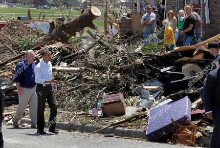 Barack Obama President Barack Obama reaches out to residents while viewing damage from the tornado that devastated Joplin, Mo., . He is joined by Missouri Gov. Jay Nixon