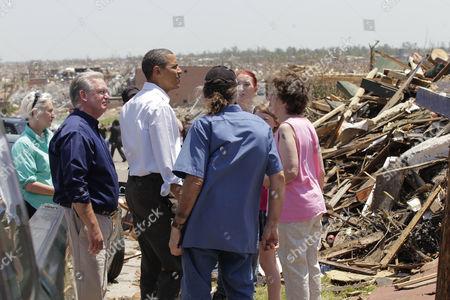 Barack Obama, Jay Nixon President Barack Obama, joined by Missouri Gov. Jay Nixon at left, views damage from the tornado that devastated Joplin, Mo