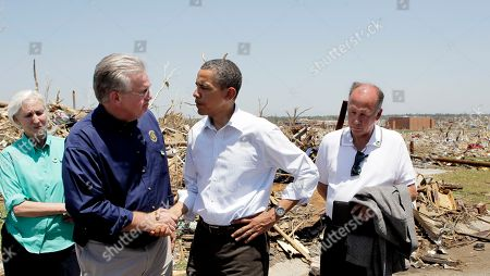 Barack Obama, Jay Nixon, Georganne Wheeler Nixon, Mike Woolston President Barack Obama, center, shakes hands with Missouri Gov. Jay Nixon, second from left, as they visit tornado victims in Joplin, Mo., . At far left is Georganne Wheeler Nixon, wife of the governor. At far right is Joplin Mayor Mike Woolston