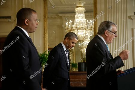 Barack Obama, Anthony Foxx, Ray LaHood President Barack Obama, center, lowers his head as he listens to Transportation Secretary Ray LaHood, right, speak, after announcing he will nominate Charlotte, NC., Mayor Anthony Foxx, left, to succeed LaHood, in the East Room of the White House in Washington