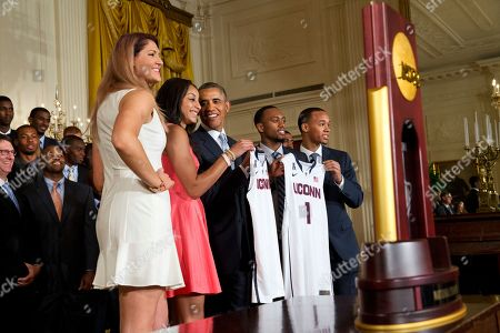Barack Obama, Bria Hartley, Stefanie Dolson, Ryan Boatright, Shabazz Napier UConn women's basketball players Stefanie Dolson, left, and Bria Hartley, and men's players Ryan Boatright, and Shabazz Napier, give jersey's to President Barack Obama, center, during a ceremony honoring the NCAA Champion UConn Huskies Men's and Women's Basketball teams and their 2014 NCAA Championships, in the East Room of the White House in Washington