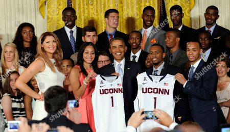Barack Obama, Stefanie Dolson, Bria Hartley, Ryan Boatright, Shabazz Napier President Barack Obama poses for a photo with the NCAA Champion UConn Huskies Men's and Women's Basketball teams in the East Room of the White House in Washington, . Obama welcomed the two team to the White House to honor their 2014 NCAA Championships. Standing in the front row with Obama are, from left, women's basketball players Stefanie Dolson and Bria Hartley, and men's players Ryan Boatright and Shabazz Napier