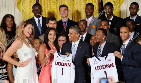Barack Obama, Stefanie Dolson, Ryan Boatright, Shabazz Napier NCAA Champion UConn Huskies Women's team member Stefanie Dolson, left, smiles at President Barack Obama during an event to welcome the NCAA Champion UConn Huskies Men's and Women's Basketball teams to the East Room of the White House in Washington, . Both teams won the 2014 NCAA Championships. Other team members presenting Obama with a jersey are Bria Hartley, Ryan Boatright, and Shabazz Napier, right