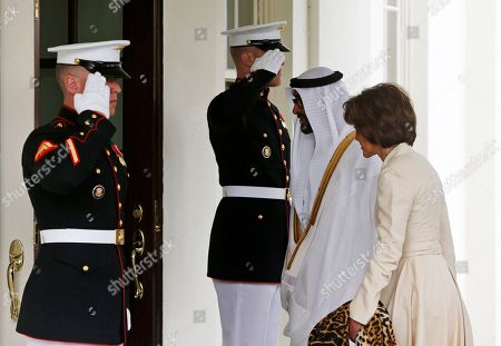 Sheik Mohammed bin Zayed al Nahyan, Capricia Marshall Saluted by two Marine Honor Guards, Abu Dhabi Crown Prince Sheik Mohammed bin Zayed al Nahyan walks into the West Wing with U.S. Chief of Protocol Capricia Marshall of the White House in Washington, for a private lunch with President Barack Obama