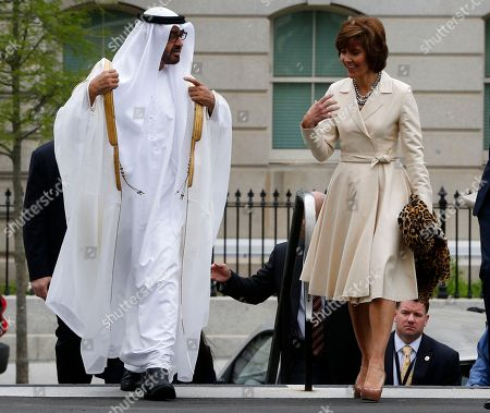 Sheik Mohammed bin Zayed al Nahyan, Capricia Marshall Abu Dhabi Crown Prince Sheik Mohammed bin Zayed al Nahyan walks with U.S. Chief of Protocol Capricia Marshall as they arrive at the West Wing of the White House in Washington, for a private lunch with President Barack Obama
