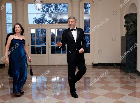 Stock Photo of George Clooney, Maria Otero Actor George Clooney arrives at the Booksellers area of the White House in Washington for the State Dinner hosted by President Barack Obama and first lady Michelle Obama for British Prime Minister David Cameron and his wife Samantha, . At left is Maria Otero, Undersecretary for Civilian Security, Democracy and Human Rights