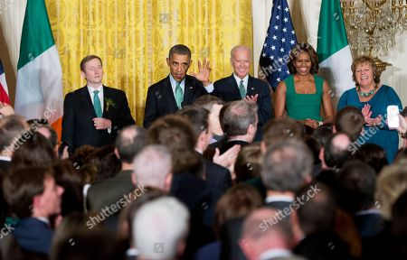 Barack Obama, Enda Kenny, Joe Biden, Michelle Obama, Fionnuala Kenny President Barack Obama, second from left, with Irish Prime Minister Enda Kenny, from left, Vice President Joe Biden, first lady Michelle Obama and Fionnuala Kenny, the prime minister's wife, wave as he speaks during a St. Patrick's Day reception in the East Room of the White House in Washington