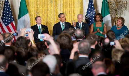 Barack Obama, Enda Kenny, Joe Biden, Michelle Obama, Fionnuala Kenny President Barack Obama, second from left, with Irish Prime Minister Enda Kenny, from left, Vice President Joe Biden, first lady Michelle Obama and Fionnuala Kenny, the prime minister's wife, makes a toast during a St. Patrick's Day reception in the East Room of the White House in Washington