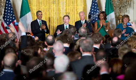 Barack Obama, Enda Kenny, Joe Biden, Michelle Obama, Fionnuala Kenny Irish Prime Minister Enda Kenny, second from left, receives an applause from President Barack Obama, from left, Vice President Joe Biden, first lady Michelle Obama, Fionnuala Kenny, the prime minister's wife, and the invited guests, as he speaks during a St. Patrick's Day reception in the East Room of the White House in Washington
