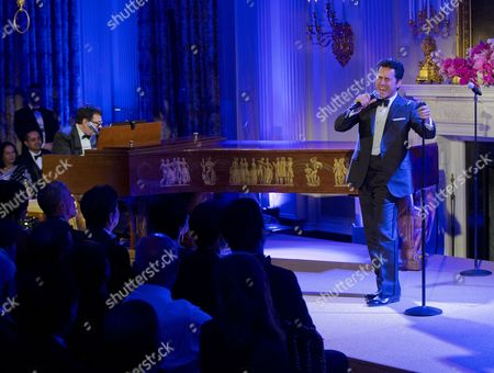 Barack Obama, Shinzo Abe, John Lloyd Young President Barack Obama, far left, and Japanese Prime Minister Shinzo Abe listen to John Lloyd Young sing during the entertainment portion of the State Dinner at the White House in Washington