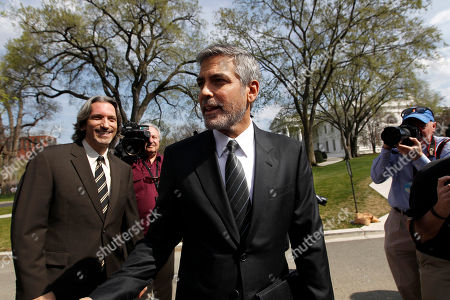 George Clooney, John Prendergast Actor George Clooney, accompanied by activist John Prendergast of the Enough Project, left, speaks to reporters outside the White House in Washington, after a meeting with President Barack Obama