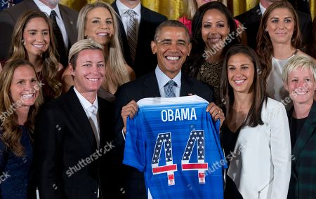 Barack Obama, Christie Rampone, Morgan Brian, Abby Wambach, Julie Johnston, Sydney Leroux, and Carli Lloyd, Alex Morgan, Megan Rapinoe President Barack Obama poses for photos with a jersey he received from head coach Jill Ellis as he welcomed the U.S. Women's National Soccer Team, in the East Room of the White House in Washington during a ceremony to honor the team and their victory in the 2015 FIFA Women's World Cup. Standing with Obama, from left are, Christie Rampone, Morgan Brian, Abby Wambach, Julie Johnston, Obama, Sydney Leroux, and Carli Lloyd, Alex Morgan, and Megan Rapinoe
