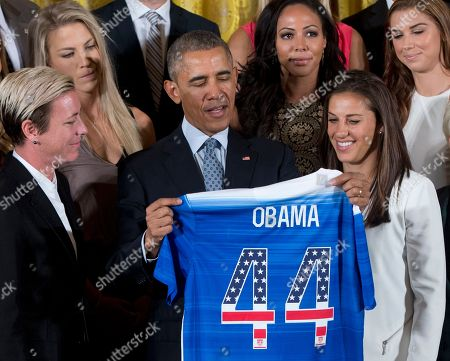 Barack Obama, Jill Ellis, Carli Lloyd, Julie Johnston, Sydney Leroux President Barack Obama receives a soccer jersey as he welcomes the U.S. Women's National Soccer Team in the East Room of the White House in Washington, during a ceremony to honor the team and their victory in the 2015 FIFA Women's World Cup. From left are Abby Wambach, Julie Johnston, Obama, Sydney Leroux, and Carli Lloyd