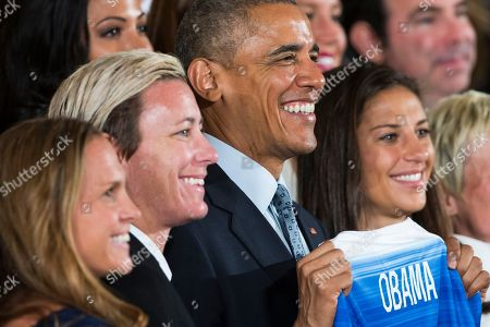 Barack Obama, Abby Wombach, Carli Lloyd, Christie Rampone President Barack Obama poses for photographs with U.S. National Soccer Team members, from left, Christie Rampone, Abby Wombach, and Carli Lloyd, during a ceremony in the East Room of the White House in Washington, to honor the 2015 FIFA Women's World Cup champions