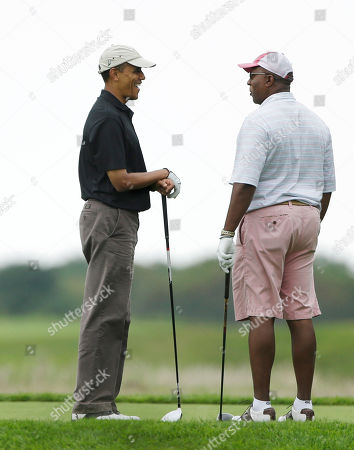 Barack Obama, Ron Kirk President Barack Obama, left, chats with former U.S. Trade Representative Ron Kirk, right, while golfing at Vineyard Golf Club in Edgartown, Mass., on the island of Martha's Vineyard