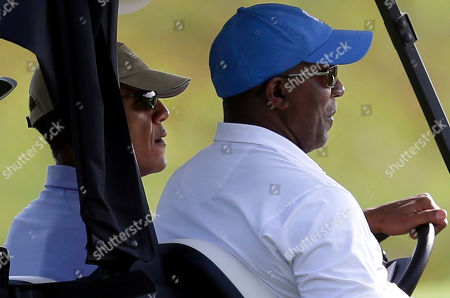 Barack Obama, Ron Kirk President Barack Obama, left, sits next to Ron Kirk as he takes the wheel of a golf cart while golfing at Vineyard Golf Club, in Edgartown, Mass., on the island of Martha's Vineyard. President Obama is taking a two-week summer vacation on the island