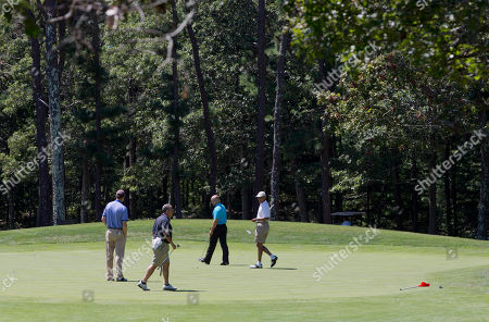 Barack Obama, Robert Wolf, Sam Kass, Marvin Nicholson President Barack Obama, right, plays golf on the first hole at Farm Neck Golf Club in Oak Bluffs, Mass., on the island of Martha's Vineyard with, from left, aide Marvin Nicholson, Robert Wolf, a Wall Street consultant, and White House chef Sam Kass, on