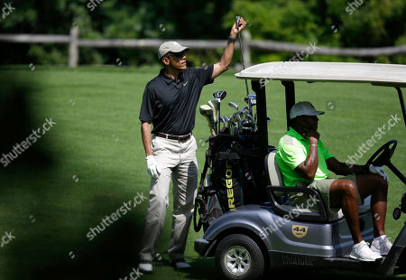 Barack Obama, Ahmad Rashad President Barack Obama selects a club while golfing at Farm Neck Golf Club as golfing partner former NFL player Ahmad Rashad, right, sits in the cart, in Oak Bluffs, Mass., on the island of Martha's Vineyard. President Obama on Saturday left Washington for his familiar spot on Martha's Vineyard for a two-week summer vacation
