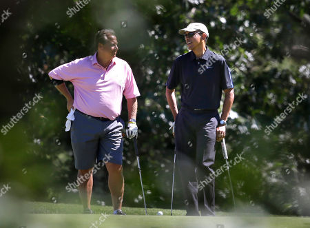 Robert Wolf, Barack Obama President Barack Obama, right, speaks with golf partner Robert Wolf, left, while golfing at Farm Neck Golf Club, in Oak Bluffs, Mass., on the island of Martha's Vineyard, . President Obama is staying on Martha's Vineyard for what is expected to be a two-week summer vacation