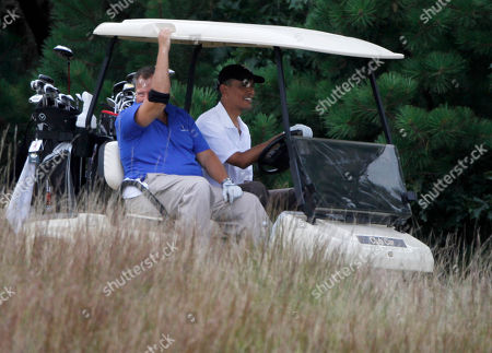 Robert Wolf, Barack Obama President Barack Obama, right, shares a golf cart with Robert Wolf, CEO of UBS America, left, while playing golf at the Mink Meadows Golf Club, in Vineyard Haven, Mass., on the island of Martha's Vineyard