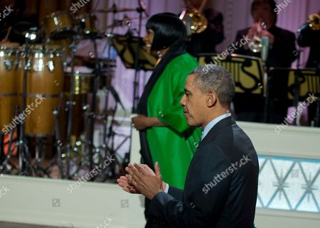 """Barack Obama, Patti LaBelle President Barack Obama applauds as he walks with Patti LaBelle to the stage during the """"In Performance at the White House: Women of Soul"""" in the East Room of the White House in Washington, hosted by he and first lady Michelle Obama. The program included performances by Tessanne Chin, Melissa Etheridge, Aretha Franklin, Ariana Grande, Janelle Monáe and Jill Scott"""