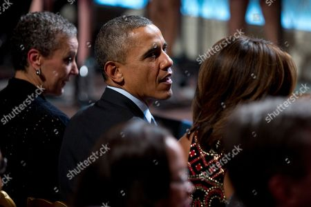 """Barack Obama, Michelle Obama, Sharon Malone President Barack Obama, center, is flanked by first lady Michelle Obama, right, and Sharon Malone, wife of Attorney General Eric Holder, as they watch the """"In Performance at the White House: Women of Soul"""" in the East Room of the White House in Washington, hosted by the president, and the first lady. The program include performances by Patti LaBelle, Tessanne Chin, Melissa Etheridge, Aretha Franklin, Ariana Grande, Janelle Monáe and Jill Scott"""