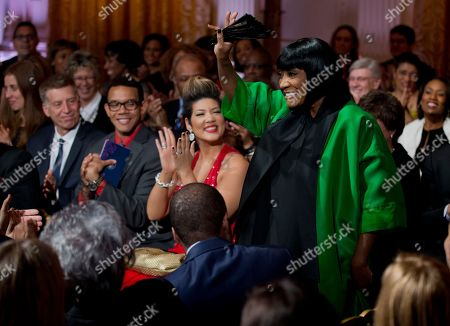 """Tessanne Chin, Patti LaBelle Patti LaBelle waves as she arrives at the """"In Performance at the White House: Women of Soul"""" in the East Room of the White House in Washington, hosted by President Barack Obama, and first lady Michelle Obama. The program include performances by Patti LaBelle, Tessanne Chin, Melissa Etheridge, Aretha Franklin, Ariana Grande, Janelle Monáe and Jill Scott. Seated to LaBelle's right wearing red is Tessanne Chin"""