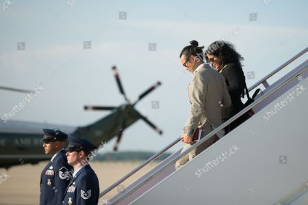 Barack Obama Maya Soetoro-Ng, the sister of President Barack Obama, right, and her husband Konrad Ngwalk, second from right, depart Air Force One at Andrews Air Force Base, Md., after the president spent a mainly personal weekend with his daughters in New York City, visiting Central Park, the Whitney Museum of American Art, and a performance of Hamilton at Richard Rodgers Theatre in Time Square, among other locations