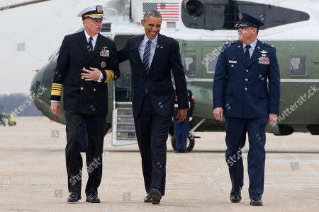 """Stock Picture of Barack Obama, Preston Williamson, James """"Sandy"""" Winnefeld President Barack Obama laughs with Joint Chiefs Vice Chairman Adm. James Winnefeld, left, and 89th Airlift Wing Vice Commander Preston Williamson, as he walks from Marine One to board Air Force One at Andrews Air Force Base, Md., en route to Atlanta. Obama is expected to speak at Georgia Tech about his plan to clamp down on the private companies that service federal student debt with a presidential memorandum he will issue on Tuesday"""