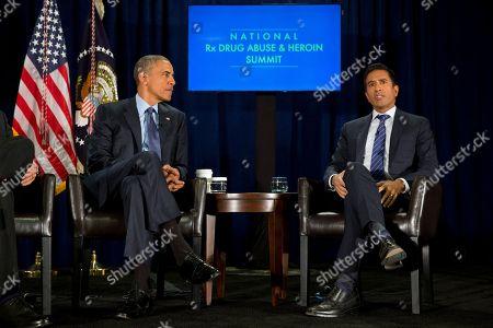 Barack Obama, Sanjay Gupta President Barack Obama listens to moderator Sanjay Gupta speaks during a panel discussion at the National Rx Drug Abuse & Heroin Summit at AmericasMart in Atlanta