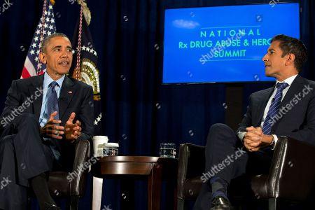 Barack Obama, Sanjay Gupta Moderator Sanjay Gupta listens as President Barack Obama speaks during a panel discussion at the National Rx Drug Abuse & Heroin Summit at AmericasMart in Atlanta