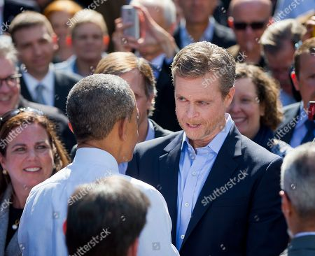 Barack Obama, Mark Parker President Barack Obama talks with Nike President and CEO Mark Parker, right, after speaking at Nike headquarters in Beaverton, Ore., . Obama visited the giant athletic apparel company to make his trade policy pitch as he struggles to win over Democrats for what could be the last major legislative push of his presidency