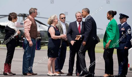 Barack Obama, Michelle Obama, Kent Conrad, Jack Dalrymple, Betsy Dalrymple, Lucy Conrad President Barack Obama and first lady Michelle Obama are greeted by North Dakota Gov. Jack Dalrymple, center, his wife Betsy Dalrymple, third from left, and former North Dakota Sen. Kent Conrad and his wife Lucy, upon their arrival at Bismarck, N.D., for a visit to the Standing Rock Sioux Tribal Nation, in Cannon Ball. It's the president's first trip to Indian Country as president and only the third such visit by a sitting president in almost 80 years