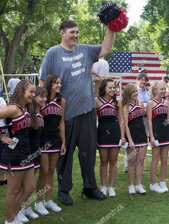 Igor Vovkovinskiy Seven-foot, eight-inch tall, Igor Vovkovinskiy, the self proclaimed biggest supporter of President Barack Obama, takes a photo with cheerleaders from the Cannon Falls high school prior to a town hall event at Lower Hannah's Bend Park, in Cannon Falls, Minn., . The President is on a three-day Midwestern bus tour
