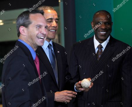 Barack Obama, Jeff Idelson, Andre Dawson President Barack Obama, accompanied by Baseball Hall of Fame President Jeff Idelson, left, and hall of fame member Andre Dawson, inducted in 2010, examines the ball that President Howard Taft threw in 1910 - the first-ever presidential opening day first pitch -- during a tour the Baseball Hall of Fame in Cooperstown, N.Y., . Obama visited the museum to highlight tourism and steps to help spur international visits to the 50 states. Obama said the overall U.S. economy and local businesses will benefit if it isn't a hassle for people from other countries to visit the U.S. and spend money at its hotels, restaurants, tourist destinations and other businesses