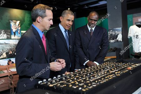 Barack Obama, Jeff Idelson, Andre Dawson President Barack Obama, accompanied by Baseball Hall of Fame President Jeff Idelson, left, and baseball hall of fame member Andre Dawson, looks over a collection of World Series rings during a tour the Baseball Hall of Fame in Cooperstown, N.Y., . President of the Hall of Fame, left, and Andre Dawson, inducted into the Hall of Fame in 2010. Obama visited the museum to highlight tourism and steps to help spur international visits to the 50 states. Obama said the overall U.S. economy and local businesses will benefit if it isn't a hassle for people from other countries to visit the U.S. and spend money at its hotels, restaurants, tourist destinations and other businesses