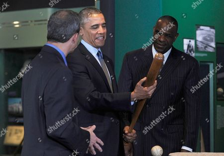 Barack Obama, Jeff Idelson, Andre Dawson President Barack Obama, accompanied by Baseball Hall of Fame President Jeff Idelson, left and baseball hall of fame member Andre Dawson, inducted in 2010, holds up Babe Ruth's bat during a tour the Baseball Hall of Fame in Cooperstown, N.Y., . Obama visited the museum to highlight tourism and steps to help spur international visits to the 50 states. Obama said the overall U.S. economy and local businesses will benefit if it isn't a hassle for people from other countries to visit the U.S. and spend money at its hotels, restaurants, tourist destinations and other businesses