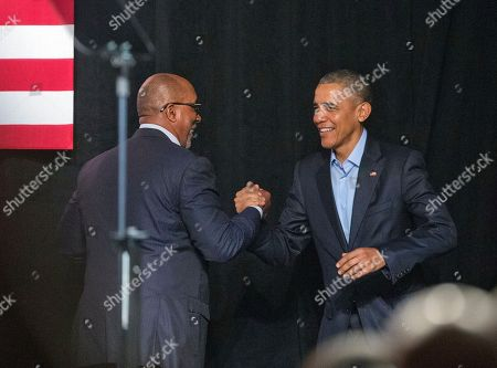 Stock Photo of Barack Obama, Ron Kirk President Barack Obam, right, is introduced, Ron Kirk, left, former U.S. Trade Representative and former Dallas mayor, at a private Democratic National Committee (DNC) fundraiser at Gilley's Club in Dallas