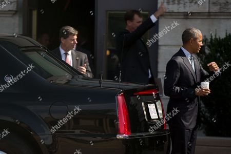 Barack Obama President Barack Obama, right, stands next to a presidential limousine after being interviewed by Pulitzer Prize winning Iowa writer Marilynne Robinson at the State Library of Iowa in the Ola Babcock Miller Building, in Des Moines. The interview will appear in the New York Review of Books