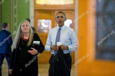 Barack Obama, Marilynne Robinson President Barack Obama, accompanied by Pulitzer Prize winning Iowa writer Marilynne Robinson, arrives at the State Library of Iowa in the Ola Babcock Miller Building, in Des Moines. Obama will sit down for an interview with Robinson which will appear in the New York Review of Books. While in Iowa, Obama is expected to officially announce a change to the college financial aid system