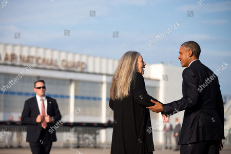 Barack Obama, Marilynne Robinson Pulitzer Prize winning Iowa writer Marilynne Robinson says goodbye to President Barack Obama before he boards Air Force One at Des Moines International Airport in Des Moines, Iowa, to fly to Andrews Air Force Base, Md. While in Iowa, Obama gave an interview with Robinson and spoke about college access and affordability at North High School