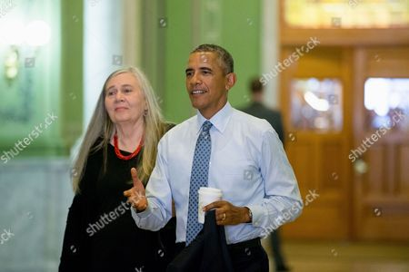 Barack Obama, Marilynne Robinson President Barack Obama, accompanied by Pulitzer Prize winning Iowa writer Marilynne Robinson, arrives to the State Library of Iowa in the Ola Babcock Miller Building, in Des Moines. Obama will sit down for an interview with Robinson which will appear in the New York Review of Books. While in Iowa, Obama is expected to officially announce a change to the college financial aid system