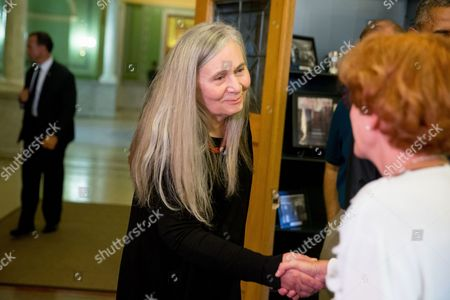 Marilynne Robinson Pulitzer Prize winning Iowa writer Marilynne Robinson greets a member of the library staff at the State Library of Iowa in the Ola Babcock Miller Building, in Des Moines. President Barack Obama will sit down for an interview with Robinson which will appear in the New York Review of Books. While in Iowa, Obama is expected to officially announce a change to the college financial aid system