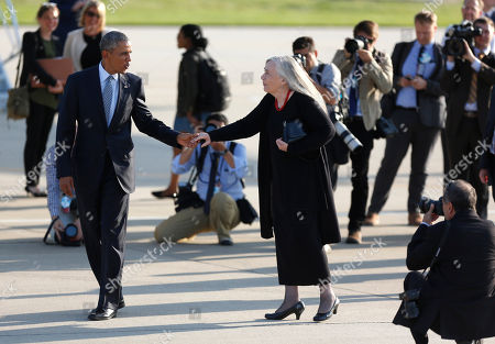 Stock Picture of Barack Obama, Marilynne Robinson Pulitzer Prize winning Iowa writer Marilynne Robinson says goodbye to President Barack Obama before he boards Air Force One at Des Moines International Airport in Des Moines, Iowa, to fly to Andrews Air Force Base, Md. While in Iowa, Obama gave an interview with Robinson and spoke about college access and affordability at North High School