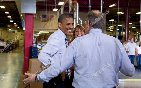 Barack Obama, Dave Cote, Lynn Braunworth President Barack Obama tours the Boiler Primary (BBP) line with Production Manager & Honeywell Operating Systems Site Leader Lynn Braunworth, center and and Honeywell CEO Dave Cote, back to the camera at left, at Honeywell in Golden Valley, Minn