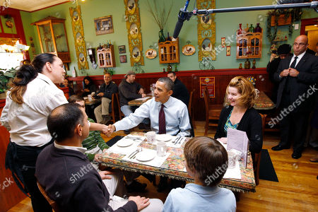 Barack Obama, Chris Corkery, Kathy Corkery President Barack Obama shakes hands with an unidentified restaurant staff member as he meets with Chris and Kathy Corkery, and their sons Andrew and Nicholas, at Julien's Corner Kitchen restaurant in Manchester, N.H
